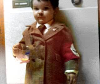 I was told that this was Ferd aka Turd as a child,donned in his Nazi costume for Halloween LMAO!!!!!