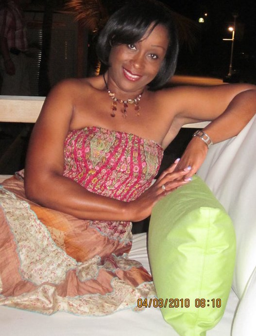 An actual recent photo of the hot MILF-news anchor for the ABS TV network in Antigua & Barbuda...