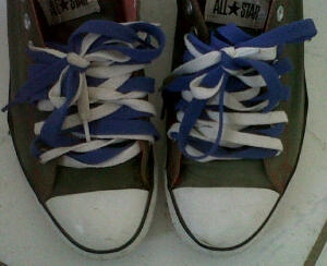 Actual peer of my ash-black colored Converses with blue & white laces to match my outfit.